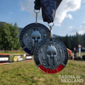 Sabina in Mudland - Spartan Race Romania Medals